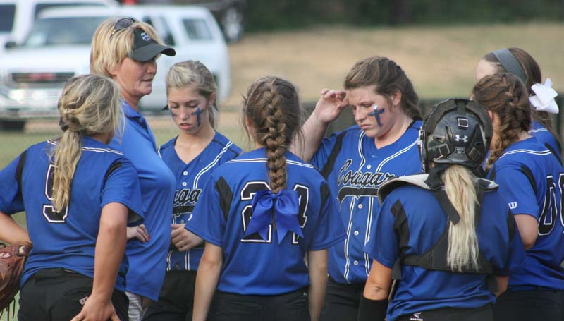 DAILY LEADER / MARTY ALBRIGHT / Brookhaven Academy head coach Becky Flowers (left) speaks to her team in between innings Tuesday night against Parklane Academy.