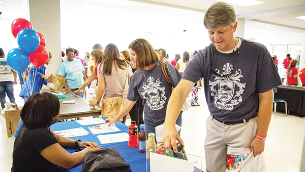 Photos submitted Brookhaven School District recently hosted a health fair for employees ahead of the start to school. Chad Leggett, a teacher at Lipsey, inspects a Monster at one of the booths.