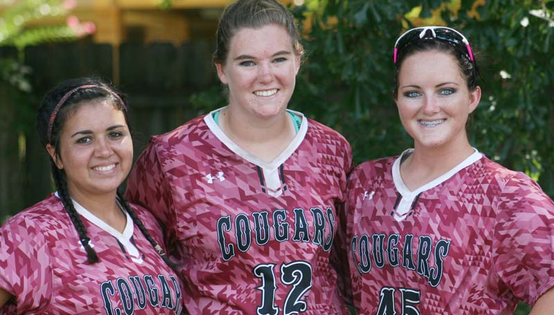 DAILY LEADER / Marty Albright / Lawrence County softball seniors (from left) Barri Rogers, Jordan Harp and Emalee Gaffney are excited to get the 2015 slowpitch season to get under way. LCHS Lady Cougars will be in action Aug. 15 at Puckett.