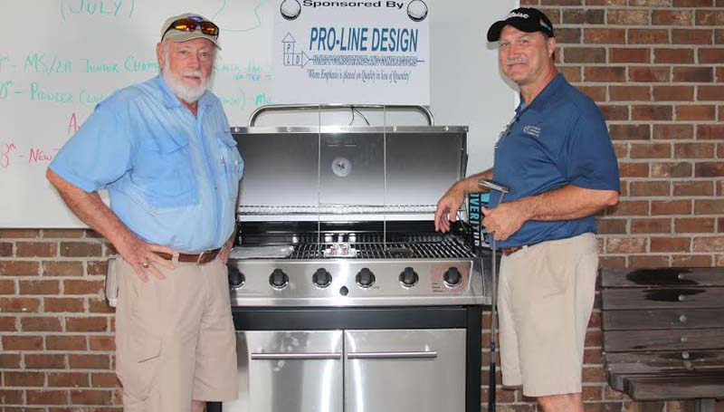 DAILY LEADER / Photo submitted / Going home with a new barbecue grill was Ronnie Touchstone (on right), winner of putting competition, shown with John Thomas (on left), president and CEO of Pro-Line Design, who sponsored this grill.