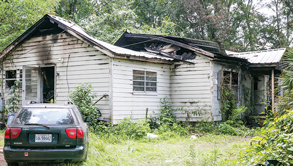 Photo by Kaitlin Mullins This home at 1804 North Jackson St. was destroyed in a fire Sunday morning. William David Love was killed in the blaze.