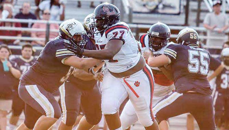 DAILY LEADER / APRIL CLOPTON / Brookhaven defensive lineman Jeffrey Johnson (77) fights through Pearl's offensive line Friday night in Pearl.