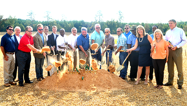 From elected officials to volunteers, many celebrated the new baseball complex during the ground breaking ceremony Friday morning. Pictured are (from left) Ryan Holmes, Bill Sones, Tillmon Bishop, Brett Smith, Quinn Jordan, Dustin Walker, McNair Smith, Dr. William Kimble, Eddie Brown, Nolan Williamson, Jimmy Diamon, Dudley Nations, David Fields, Rev. Jerry L. Wilson, Sally Doty, Mary Wilson, Becky Currie and Joe Cox.