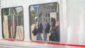 Photos by Luke Horton At top: Passengers can be seen through the windows of the Amtrak train as it passes through Brookhaven recently. Above: Travelers wait at the Brookhaven station for the train to arrive.