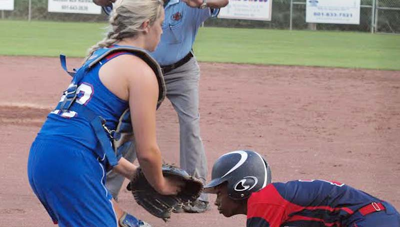 DAILY LEADER / TRACY FISCHER / Brookhaven's Cheyenne Motley (right) reaches home safely before Wesson catcher Kaitlyn Smith (23) could apply the tag Thursday night.