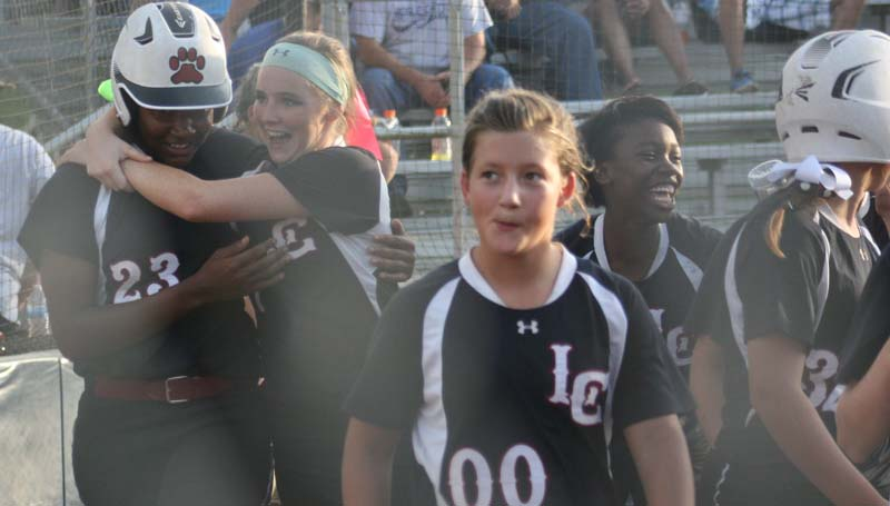 DAILY LEADER / MARTY ALBRIGHT / Lawrence County's Zyon Feazell (23) is congratulated by her teammates after hitting a solo home run in the second inning against Bogue Chitto Thursday night.