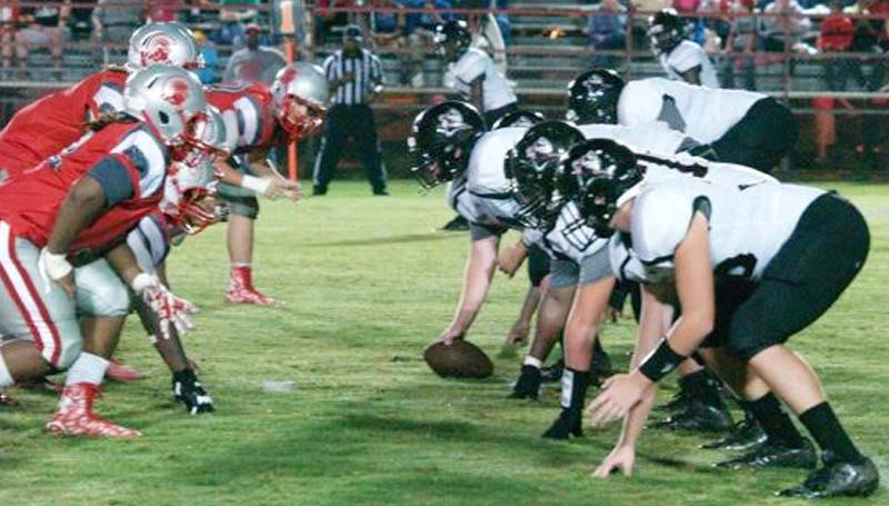 DAILY LEADER / JANA HARP / Lawrence County's offensive line prepares to make the snap Friday night against Magee.