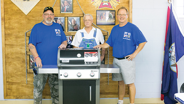 Photos by Kaitlin Mullins Quarter Master Greg Marlow (left) stands with grill winner Gene Butler (center) and Post Commander Ken Powell.