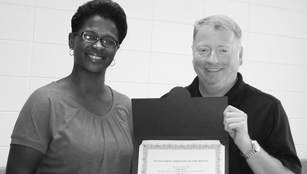 Photo submitted During the August Director's Meeting, Mississippi Adolescent Center recognized Employee of the Month for July. Pictured are (from left) Angie Hardy, recipient, and William Gates, director of MAC.