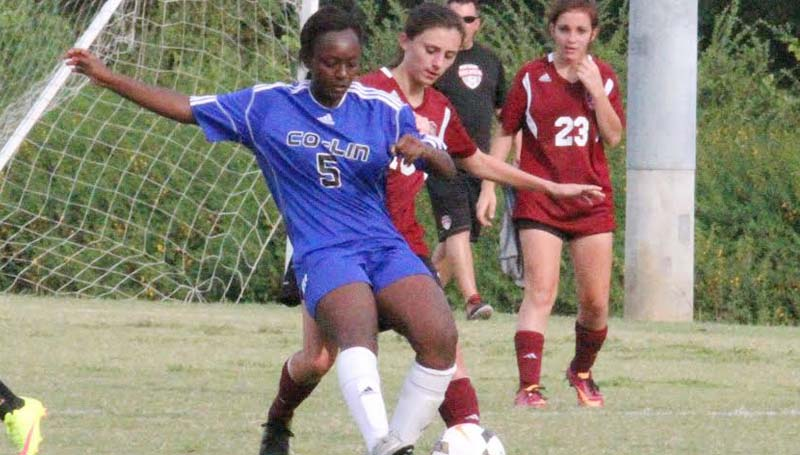Co-Lin Media / Natalie Davis / Copiah-Lincoln forward S' Middleton, seen here battling for possession, scored the lone goal for the Lady Wolves in a 5-1 loss to Holmes.