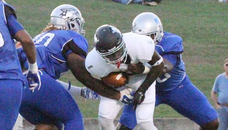 Co-Lin Media / Natalie Davis / Co-Lin's Joe Anderson (96) and Tre' Brown (40) tackle East Mississippi running back D.J. Law (1) in the backfield.