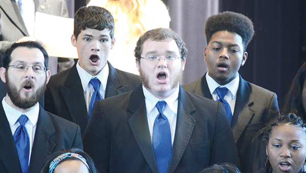 Photos by Luke Horton Members of the Co-Lin choir sing the school's Alma Mater during a 100-year celebration event at Rea Auditorium Thursday.