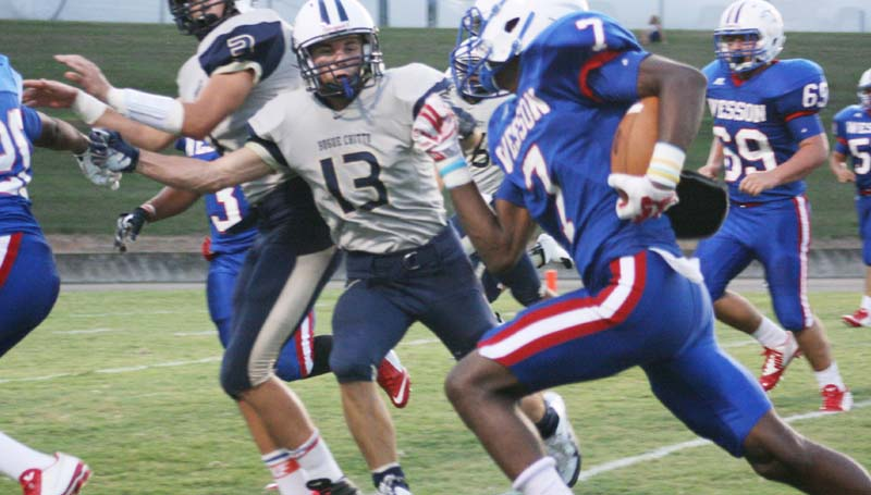 Daily Leader / Marty Albright / Wesson running back Eric Rhymes (7) follows his blockers down the field as Bogue Chitto's defender Kolby Roberts (13) looks to make the stop Friday night at Stone Stadium.