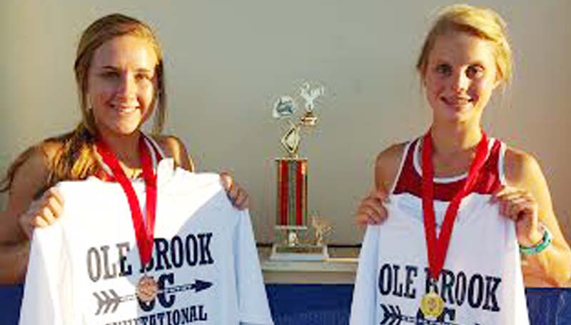 Daily Leader / Photo submitted / Loyd Star girls varsity cross country team placed seconds in the Ole Brook Invitational Meet on Thursday. Abby Thomas (right) placed first overall in the female run, while Julie Smith (left) placed third overall.
