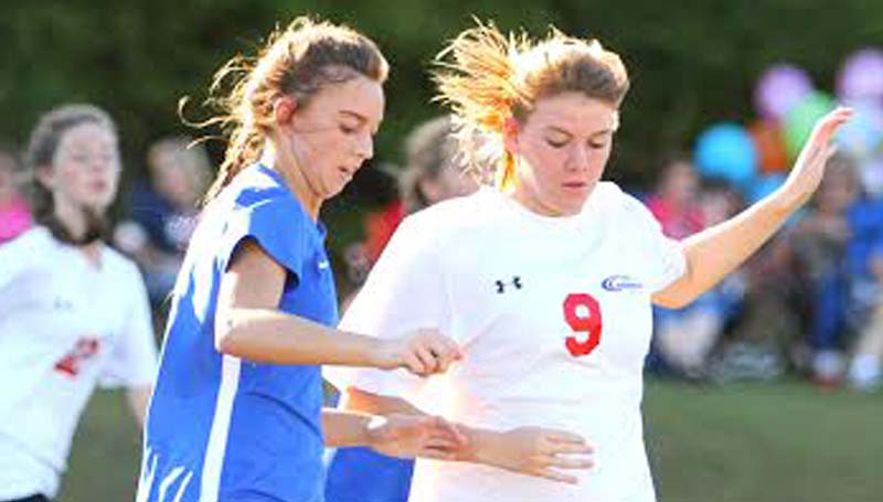 Daily Leader / Sherylyn Evans / Brookhaven Academy's Shelby Flumm (left) battles for possession against Copiah Academy Monday.