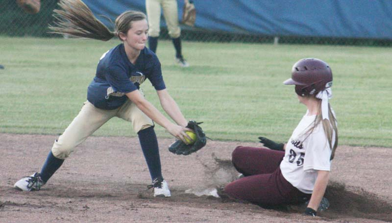 Daily Leader / Marty Albright / Bogue Chitto second baseman Karly Leake (left) attempts to make the tag on Stringer's runner as Abby Parker slides in safely at second base Monday night.