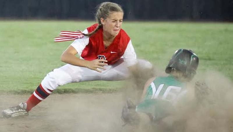 Daily Leader / April Clopton / Brookhaven second baseman Kat Wallace records the out at second base as West Lincoln's runner Peyton White (16) slides in Tuesday night.