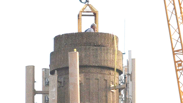 Photo by Luke Horton You Asked: What is being done to the large tower-shaped structure near the Amtrak station on North Railroad Avenue?  A: Crews are adding new wireless antennas to the structure, which was once a smokestack for the city's power plant. A crew member on the site Thursday morning said people should notice better wireless reception when the work is complete.