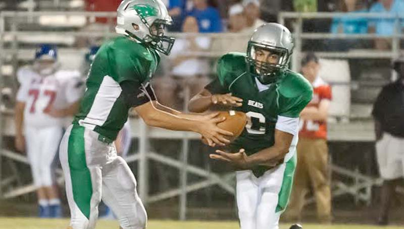 Daily Leader / Teresa Allred / West Lincoln quarterback Jayden Rushing (3) hands off the ball to Chance Lacking (6) in Friday night action against Pass Christian at Perry Miller Field.