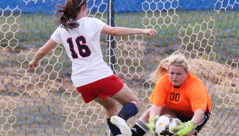 Co-Lin Media / Natalie Davis / Co-Lin goal keeper Destiny Allen of Brookhaven gets the save on the shot by Northwest's Tristan Kitchens (16).