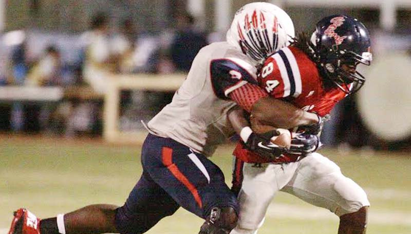 Daily Leader / Jonathon Alford / Brookhaven's Zarian Harper tries to hold on to the ball as South Jones defender Scott Phillips reaches in for the strip Friday night.