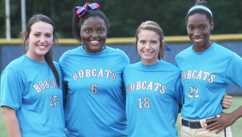 Daily Leader / Marty Albright / The Bogue Chitto Lady Cats honored their slowpitch softball seniors (from left) Brooke Myers, Christian Black, Alana Nettles and Zariah Matthews in Tuesday night action against West Lincoln.