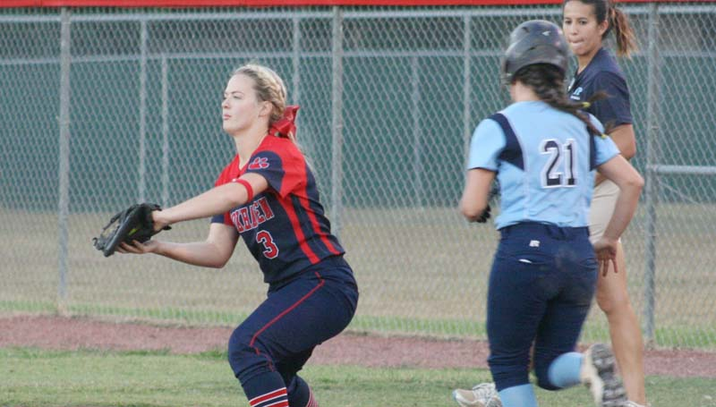 Daily Leader / Marty Albright / Brookhaven first baseman Katherine Shell secures an out at first base just before North Pike's runner Baylee Bryant (21) could reach Thursday night.