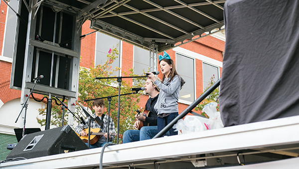 """Photos by Kaitlin Mullins From right, John Michael Chance, Greg Smith and Chloe Smith collaborated for a cover of """"Radioactive"""" by Imagine Dragons. They were one of many talent-filled performances that made the stage a hot spot at the festival."""