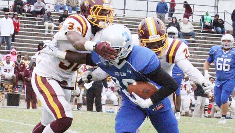 Co-Lin Media / Natalie Davis / Co-Lin wide receiver Jalen Smith (10) is wrestled down by Pearl River's Tekodee Peters (32) and Tarvarious Moore (2) in Saturday's JUCO action at Stone Stadium.