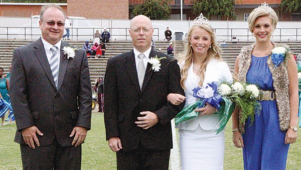 Greta Carley of Columbia (second from right) was crowned Copiah-Lincoln Community College's 2015 homecoming queen during ceremonies prior to the football game on Saturday. Greta is the daughter of Trey (second from left) and Amy Carley of Columbia. Making the presentation were Co-Lin President Ronnie Nettles (far left) and 2014 homecoming queen Caroleah Brister of Bogue Chitto.