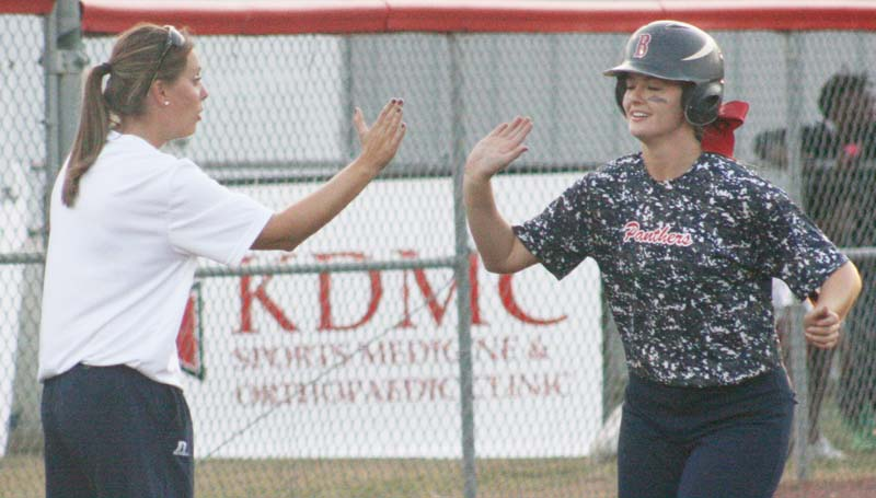 Daily Leader / Marty Albright / Brookhaven's Katherine Shell receives an congratulation high-five from her coach Mandy Vinson (left) at third base after hitting a pair of two-run home runs Tuesday against Murrah.