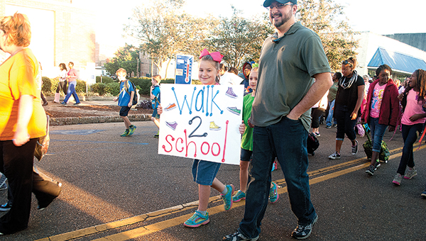 Photos by Julia V. Pendley Brookhaven Elementary School students celebrated National Walk to School Day by meeting at the Chamber of Commerce and making the short trek to school Wednesday morning.