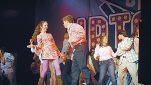 Students perform a disco song Thursday evening.