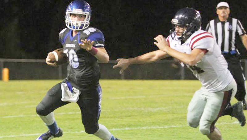 """Daily Leader / Sherylyn Evans / Brookhaven Academy quarterback Madison Smith (10) runs to the outside to get away from a ASC defender Friday night at R.M. """"Red"""" Stuard Field."""