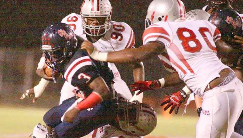 Daily Leader / Jonathon Alford / Brookhaven's senior running back Thomas Poole fights through several Provine defenders to help his Panthers collect their first win Friday night at King Field.