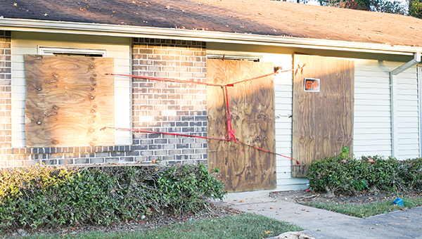 Photos by  Kaitlin Mullins The apartment where a suspect holed up in an hours long-standoff Monday has been boarded up.