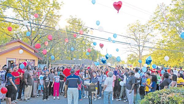 Photos by Xavier Wilcher Friends, family and loved ones of the late Jevonta Dickey and Shaquan Richardson gathered to release balloons in their memory Wednesday.