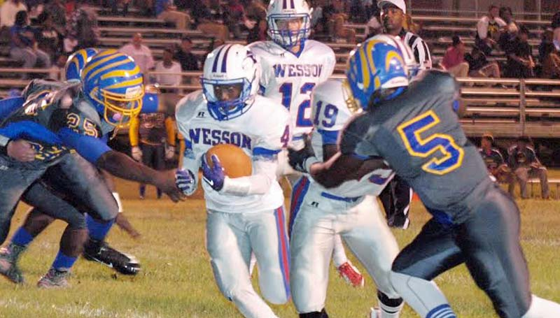 Daily Leader / Tracy Fischer / Wesson Jermaine James (4) hits the gap as teammate Tre Glasper (19) provides a block against Jefferson County's linemen James Claiborne Jr (5) in Friday night action in Fayette.