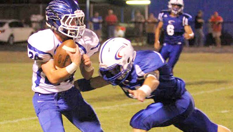 Daily Leader / Sherylyn Evans / Brookhaven Academy's senior Grant James (24) prepares to take a hard hit from a Copiah Academy defender Friday night in MAIS football action in Gallman.
