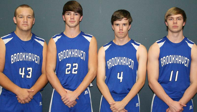 Daily Leader / Marty Albright / Seniors playing basketball for the Brookhaven Academy Cougars are (from left) Roger Rushing, Ross Felder, Hunter Griffin and Austin Smith.