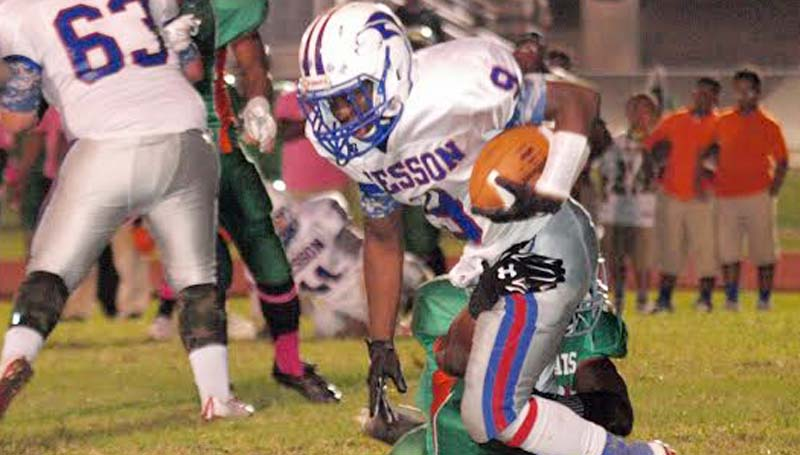 Daily Leader / Tracy Fischer / Wesson Cornelius Barlow (9) fights off Wilkinson County Juntavious Cage (4) for a big gain Friday night.