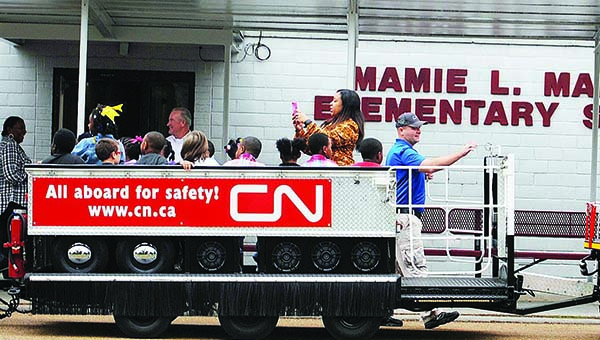 Photos by Aaron Paden / Mamie Martin's students take turns riding Little Obie after listening to a presentation on train safety Monday.
