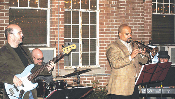 Photo by Aaron Paden Tyler Bridges, Nick Bridges, Damian Gatlin, and Marvin Curtis jam out at the Taste of Trust fundraiser Thursday night.
