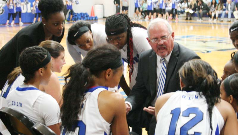 DAily Leader / Marty Albright / Co-Lin women's coach Gwyn Young talks to his players during a timeout in the fourth quarter against Holmes in JUCO basketball action Monday night at Mullins Gymnasium.