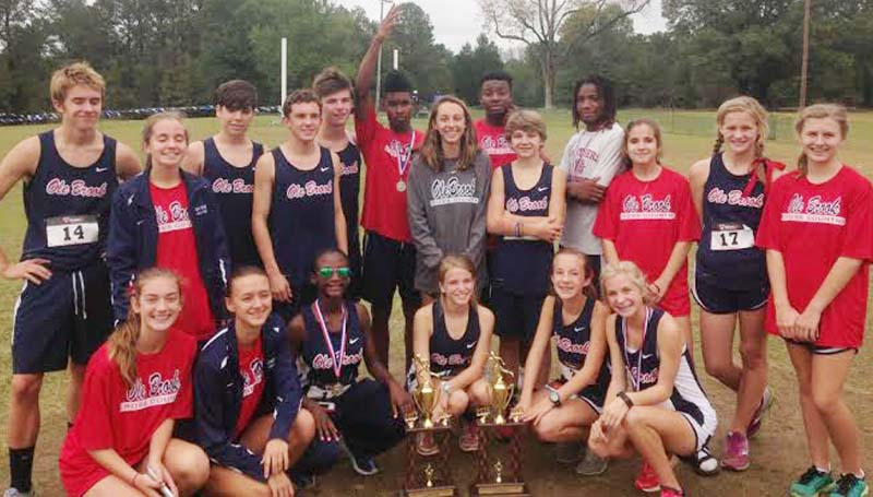 Daily Leader / photo submitted / The Brookhaven Panthers and Lady Panthers capture first place in both the boys and girls cross country regional meet in Clinton.