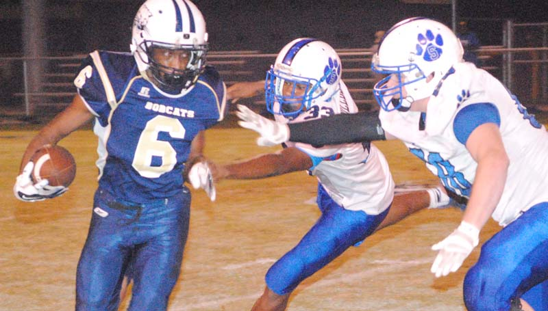 Daily Leader / Marty Albright / Bogue Chitto's junior running back Terrance Morgan eludes two Springfield defenders in Thursday night action at Troy Smith Field.