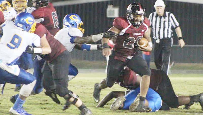 Daily Leader / Patty Emfinger / Lawrence County's senior T-Tez Cole powers through Columbia's defense Thursday night in Class 4A playoff action in Monticello.