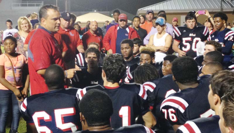 Daily Leader / Marty Albright / Brookhaven head coach Tommy Clopton talks to his players during a team huddle after the game to congratulate them on a job well done Friday night.