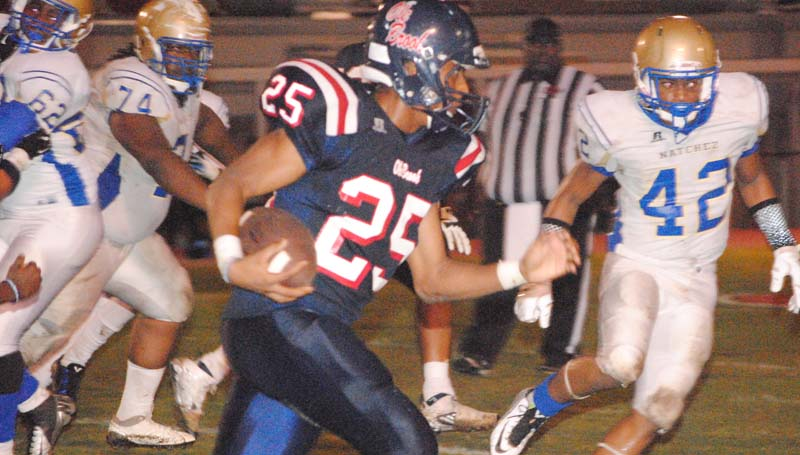 Daily Leader / Marty Albright / Brookhaven's Kenneth Dixon (25) powers the ball down the field against Natchez Friday night.