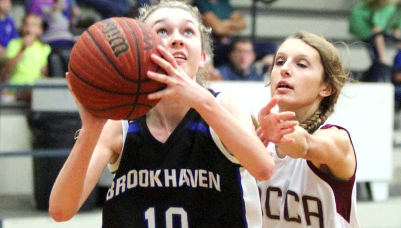 Daily Leader / Sherylyn Evans / Brookhaven Academy's Edie Riley (10) prepares to take a shot while WCCA's Bailey Devers (33) tries to block the shot Tuesday night.